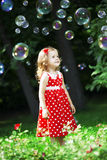 Cute little girl with bubbles Stock Image