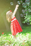 Cute little girl with bubbles Stock Photography
