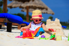 Cute little girl building sandcastle on summer Royalty Free Stock Image
