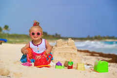 Cute little girl building sandcastle on tropical Stock Photography