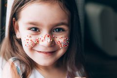 Cute little girl with bunny ears on pink background. Easter child portrait, funny emotions, surprise. Copyspace for text royalty free stock image