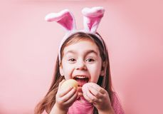 Cute little girl with bunny ears on pink background. Easter girl portrait. Cute little girl with bunny ears on pink background. Easter child portrait, funny stock photos
