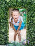 Cute little girl with the bush Stock Photo