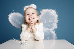 Cute little girl with butterfly costume Royalty Free Stock Photos