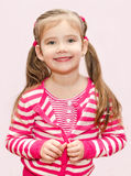 Cute little girl buttoning her jacket Stock Photography