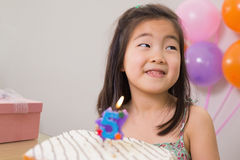 Cute little girl with cake at her birthday party Royalty Free Stock Photography