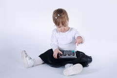Cute little girl with calculator Royalty Free Stock Images