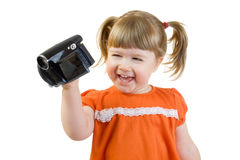 Cute little girl with camcoder Stock Photos