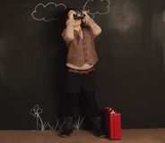 Cute little girl with camera Royalty Free Stock Photos