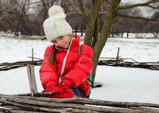 Cute little girl in a cap and jacket smiles Royalty Free Stock Photos