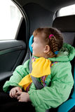 Cute little girl in the car Royalty Free Stock Photos