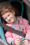 Cute little girl in a car Royalty Free Stock Photo