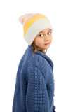 Cute Little Girl. In a cardigan and a hat looking over the shoulder royalty free stock image