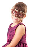 Cute little girl in a carnival mask. Cute little girl in a dress and carnival mask Royalty Free Stock Images