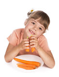 Cute little girl with the carrot Stock Photos