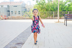Cute little girl carrying leaves Royalty Free Stock Images