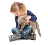 Cute little girl with cat in hands Royalty Free Stock Photos