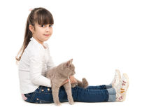 Cute little girl with cat in hands Royalty Free Stock Images