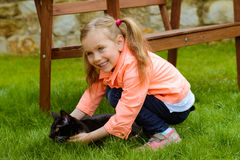Cute little girl with cat. Outdoor Royalty Free Stock Photography