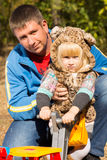 Cute little girl in a cat suit Stock Images
