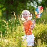 Cute little girl catching butterflies and bugs with her scoop-net Royalty Free Stock Photography