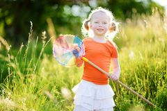 Cute little girl catching butterflies and bugs with her scoop-net Royalty Free Stock Photo