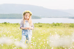 Cute little girl in the chamomile field Stock Images