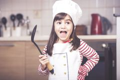 Cute little girl in the kitchen Royalty Free Stock Photography