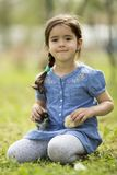 Cute little girl with chickens Stock Image