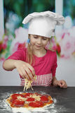 Cute little girl in chief hat Royalty Free Stock Photography