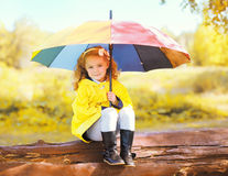 Cute little girl child with colorful umbrella Royalty Free Stock Images