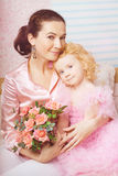 Cute little girl, a child in a dress with mother Stock Photos
