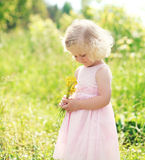 Cute little girl child with flowers in spring Stock Photography