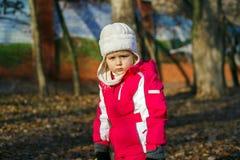 Cute little girl on child playground Stock Photos