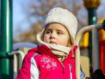Cute little girl on child playground Royalty Free Stock Images