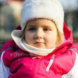 Cute little girl on child playground Stock Photo