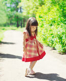 Cute little girl child wearing a dress outdoors in summer Royalty Free Stock Image
