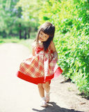 Cute little girl child wearing a dress outdoors in sunny summer Stock Photography