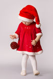 Cute little girl with christmas ball Royalty Free Stock Image