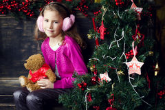 Cute little girl in Christmas decorations Stock Images