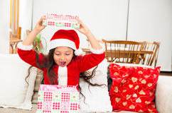 Cute little girl in Christmas dress holding Stock Images
