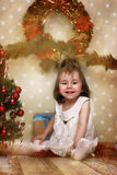 Cute little girl and Christmas tree Stock Image