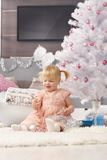 Cute little girl with christmas tree Royalty Free Stock Images