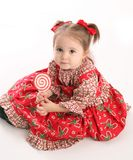 Cute little girl in Christmas wear Stock Images