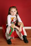 Cute little girl in Christmas wear Stock Image