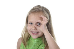 Cute little girl circling eye in body parts learning school chart serie. 6 or 7 years old little girl with blond hair and blue eyes smiling happy posing isolated royalty free stock photos