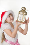 Cute little girl in claus hat Royalty Free Stock Photo