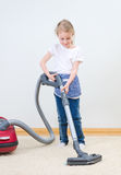 Cute little girl cleaning carpet. Stock Photography