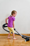 Cute little girl cleaning floor Stock Photography