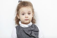 Cute little girl, close-up, light background royalty free stock photos